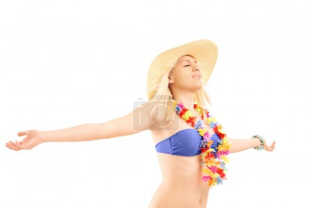 Blond female spreading her arms