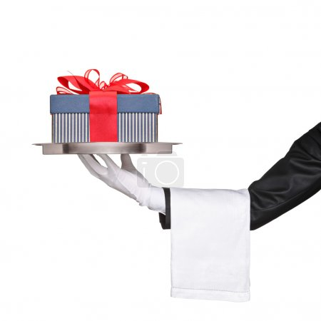 Waiter holding tray with gift