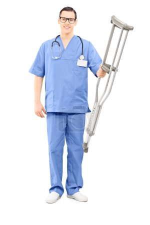 Healthcare professional holding crutches