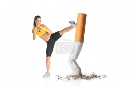 Photo for Girl kicking a cigarette butt isolated against white background - Royalty Free Image