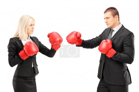 Photo for Young businesspeople with boxing gloves having a fight isolated against white background - Royalty Free Image