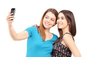 Two teenagers taking pictures of themselves