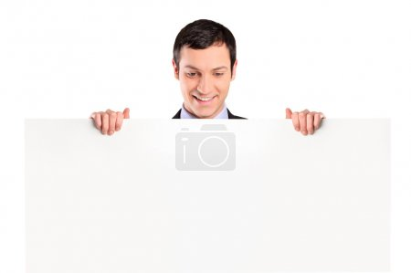 Businessman looking at white banner