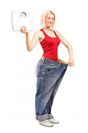 Weight loss female holding weight scale