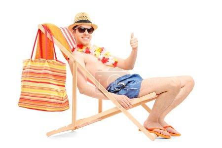 Happy man on beach chair