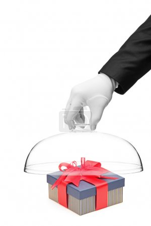 Gloved hand covering a gift box