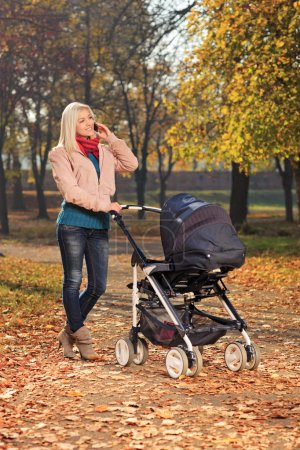 Mother on phone during walk with baby
