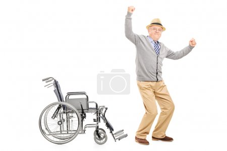 Senior standing up from wheelchair