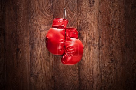Photo for Pair of boxing gloves hanging on a wooden wall - Royalty Free Image