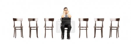 Bored man on chair