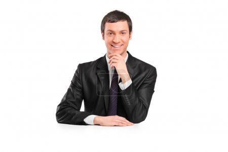 Businessman sitting on imaginary table