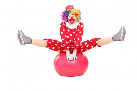 Clown performing on pilates ball