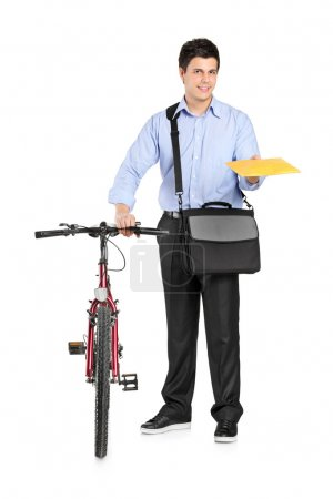 Photo for Mail man next to a bicycle holding an envelope isolated on white background - Royalty Free Image