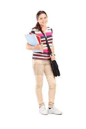 Schoolgirl holding notebooks