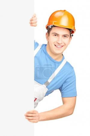 Male worker behind blank panel