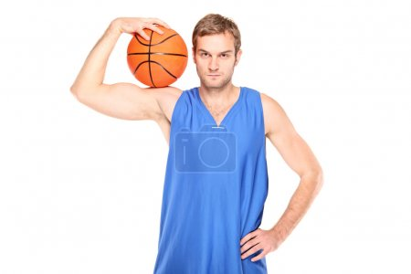 Basketball player holding basketball