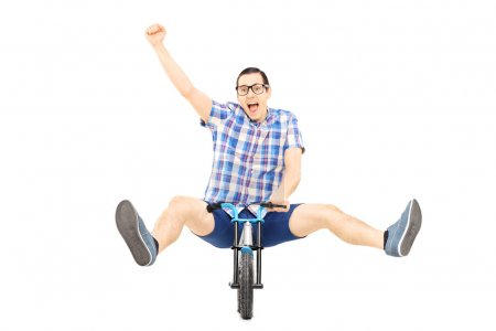 Male riding small bicycle