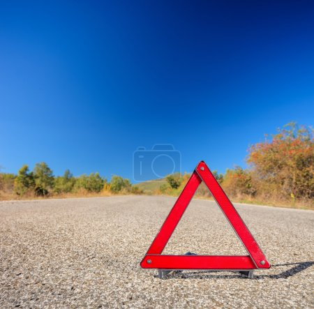 Red warning triangle on road
