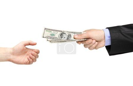 Hand handing money to another hand
