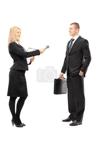 Female interviewer talking to businessman