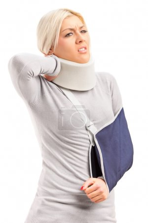A blond woman with broken arm and injured neck suffering from a pain