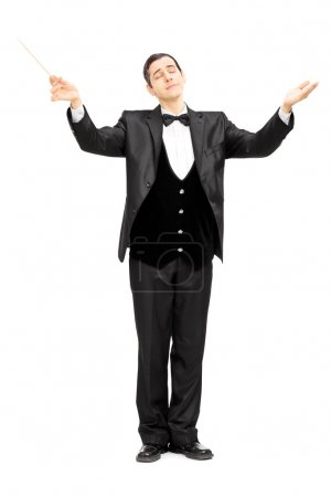 Male orchestra conductor directing