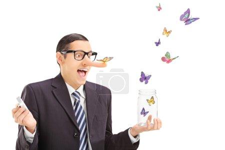 Man looking at butterflies