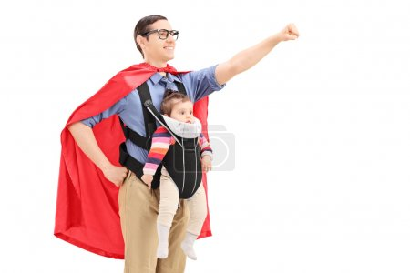 Male superhero carrying baby