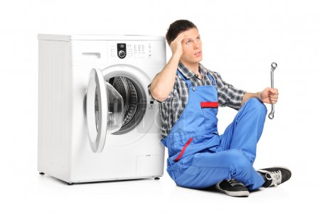 Plumber fixing washing machine