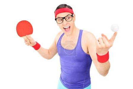 Man holding ping pong bat