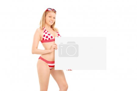 Photo for Attractive woman in bikini holding a blank banner isolated on white background - Royalty Free Image