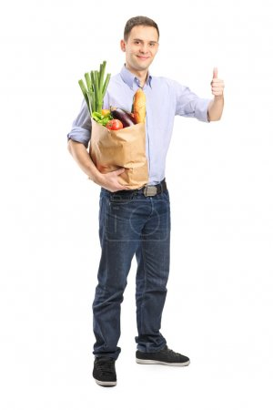 Man holding bag of groceries