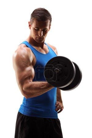 Muscular young man lifting barbell