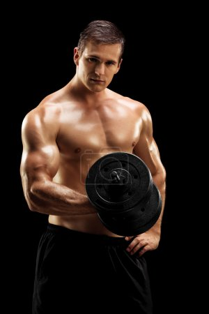 Photo for Handsome bodybuilder exercising with barbell isolated on black background - Royalty Free Image