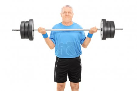 Photo for Strong elderly man holding a heavy weight isolated on white background - Royalty Free Image