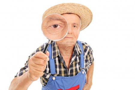 Farmer looking through magnifying glass