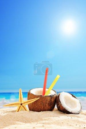 Coconut cocktail on sandy beach