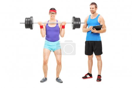 Guy exercising with fitness trainer