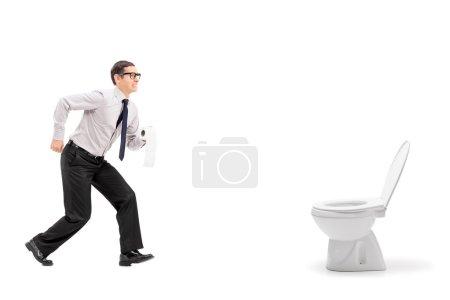 Man rushing to urinal