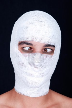 man with a bandaged head