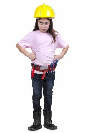 Photo pour Petite fille en vêtements de construction sur fond blanc - image libre de droit