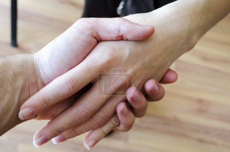 Friendly Handshake. Man And Woman Shaking Hands.