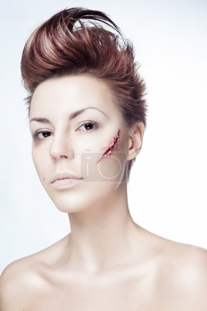 Girl with a cut on face