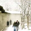 People walk near the Deoksugung Palace in South Ko...
