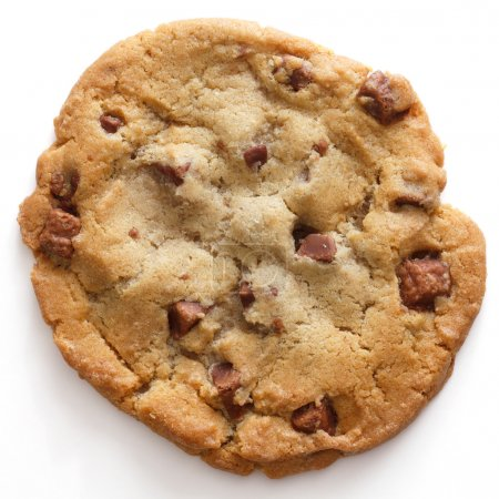 Photo for Large light chocolate chip cookie on a white surface shot from above - Royalty Free Image