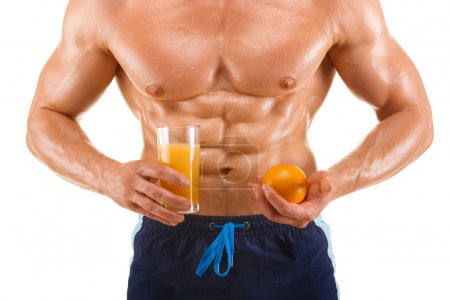 Shaped and healthy body man holding a juice and orange, shaped abdominal, isolated on white background