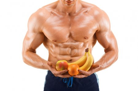 Shaped and healthy body man holding a fresh fruits, shaped abdominal, isolated on white background