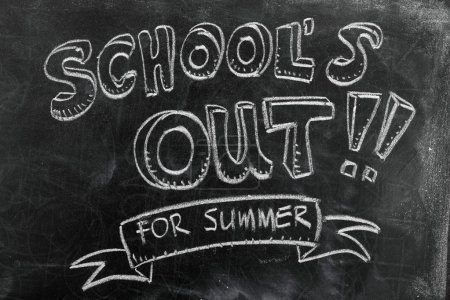 Photo for School's out for summer on blackboard - Royalty Free Image