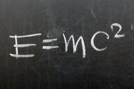 Photo for Formula. Theory of relativity written on school chalkboard - Royalty Free Image