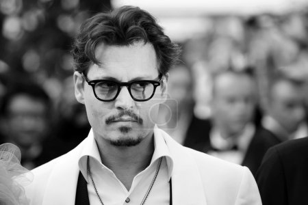 Photo for CANNES,FRANCE - 14 MAY 2011: Actor Johnny Depp attends the 'Pirates of the Caribbean: On Stranger Tides' Premiere during the 64th Annual Cannes Film Festival at Palais des Festivals on May 14, 2011 in Cannes, France. - Royalty Free Image